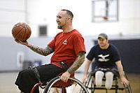 Navy Wounded Warrior Shines in Adaptive Sports: Retired Navy Aviation Electricians Mate Steven Davis rolls through basketball practice for the Navy's Warrior Games basketball team at State College, Pa. (U.S. Navy photo by EJ Hersom/Released)