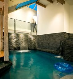 Wow! Blue Lagoon indoor swimming pool designed by Logue Studio Design. Featured on Glo Living: Amazing Childlike Homes