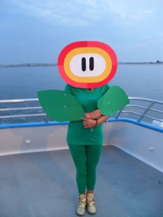"Seems pretty easy to put together, but you can definitely tell he/she is dressed as a fire flower. ""Fire Flower Costume from Super Mario Brothers"" Mario Costume Diy, Super Mario Bros Costumes, Costume Ideas, Super Mario Party, Family Halloween Costumes, Halloween 2017, Halloween Ideas, Nintendo Party, Flower Costume"