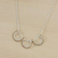 sparky bloom: triple horseshoe gold and silver necklace handmade by Freshie & Zero