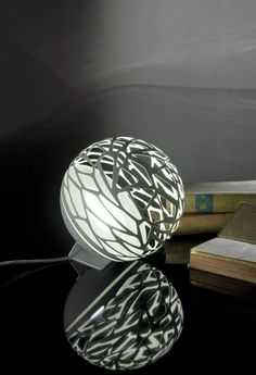 Kelly Sphere Lamps, Orbit light ;) Click here, http://www.arturbane.com/collections/light/products/kelly-sphere-lamps. They are made of #white #metal with laser cut openings that create a game of #light and #shadows.