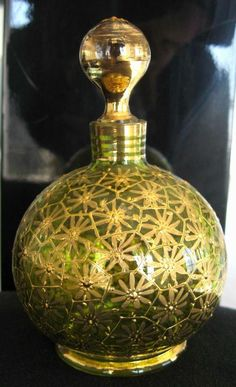Lime Green Perfume Bottle. It is hand decorated with gold.