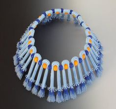 Reduce and Reuse...a fabulous necklace of Soda Straws,Pony Beads  Bristles From a Brush by Karen Lauseng  http://www.kjartworks.net/artiststatement.html