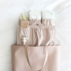 Transform your favorite designer bag into an organized diaper bag, mom bag, day bag, or work bag. With pockets for days so you can keep all of your essentials organized. Say goodbye to ugly baby bags and hello to your dream diaper bag. Best Backpack Diaper Bag, Boy Diaper Bags, Diaper Bag Backpack, Stylish Diaper Bags, Diaper Caddy, Oversized Handbags, Diaper Bag Essentials, Diaper Bag Organization, Baby Necessities