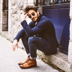 Blue textured cardigan with blue denim jeans and tan boots.