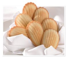 Sugar Bowl Bakery Madeleines - Baked to be firm yet delicately crunchy, our petite French cake cookies are the answer to a sweet tooth craving.  Serve these at your next dinner party or just indulge in them with a hot cup of tea or coffee.