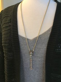 A personal favorite from my Etsy shop https://www.etsy.com/listing/260742662/silver-y-necklace-with-medallion