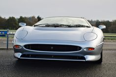 Jaguar was born an instant classic sports-car although sadly, not destined for mass-production. It's specs have made it the first car to beat 220 MPH, hence Classic Sports Cars, Classic Cars, Jaguar Xj220, First Car, Super Cars, Beats, Vehicles, Vintage Classic Cars, Car
