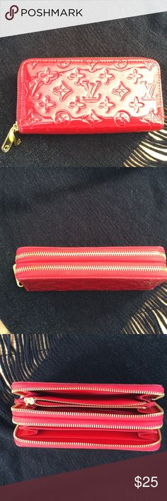 Fashion wallet Red patent look. Double zipper. Room for lots of credit cards bills and coins. Outside perfect condition. Inside clean all but one spot. See 4th picture. No markings on all other compartments. This is unbranded and I do not know the maker so not authentic anything. Bags Wallets