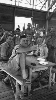 Men of No. 1 Aerodrome Construction Sqn, RNZAF, enjoying Christmas Dinner, Tebrau, Malaya. 25th December 1941. (RNZAF Archives)
