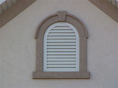 round top gable vent with stucco band