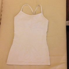 NWOT Lululemon Ivivva White Power Y Tank XS 4 NWOT! Only worn once! Made by Ivivva (Lululemon's children's brand). This Tumblin' Tank is a kids size 14, and it is identical to Lululemon Power Y Tank in size 4. Super cute and versatile - goes with anything!The material is Luon fabric. There are slots for cups - I can include cups if you ask. Happy poshing! lululemon athletica Tops Tank Tops