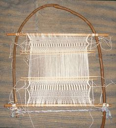 """Bent Cane Språng Tapestry Project by Ellen Shipley: """"heres the middle portion starting to be spread out. I'm thinking the best way to work the tapestry is to take it off the språng loom and tack it onto a foam core board."""" <> See web site for continuation of project."""