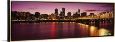 Canvas with Floating Frame entitled Skyscrapers lit up at sunset, Willamette River, Portland, Oregon, USA, 1994, Gold