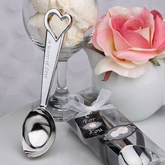 A Scoop of Love Ice Cream Scoop Wedding Favors (FashionCraft 4216)   Buy at Wedding Favors Unlimited (http://www.weddingfavorsunlimited.com/a_scoop_of_love_ice_cream_themed_favor.html).