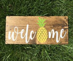 This listing is for 1 pineapple welcome hand stenciled wood sign. Wood is solid pine and measures approximately 5.5 x 12. Stands up for display. Sawtooth hanger not included, but can be added at checkout. **In note to seller please indicate which color paint and stain you would like, if different from picture above. (dark walnut stain pictured) The current turn around time is 5-7 business days after receipt of payment and shipped USPS Priority Mail or First Class. Colors on monitor may… Pineapple Kitchen, Pineapple Art, Pineapple Room Decor, Pineapple Decorations, Pineapple Ideas, Stencil Wood, Summer Signs, Diy Signs, In Kindergarten