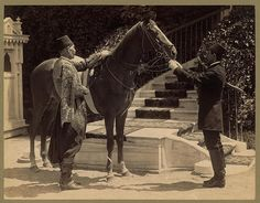 One of Sultan Abdulhamid's horses (Most probably, Asil), with two men in front of a stairway. Another picture from Sultan Abdulhamid's collection by Abdullah Brothers. 1883.