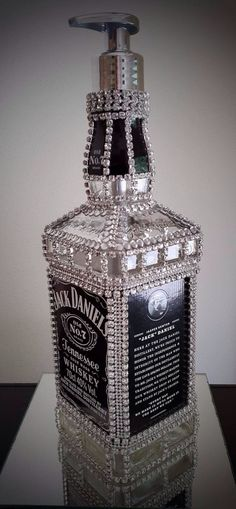 Soap dispenser made from a jackdaniels bottle. With crystal cupchain and hotfix.