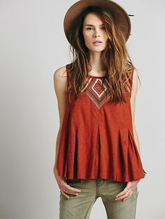 V-shape for the embroidery is a great call. Flattering. Also go pleat