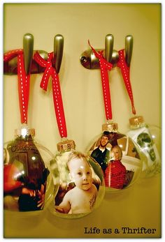 Picture Ornaments - For next year, print the photo, cut out the person, laminate the photo, then cut around in a circle to make the picture float inside the ornament....(much easier than running them...