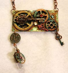 Steampunk Plate Necklace, keys gears, coin, light bulb on a metal plate from an old clock.