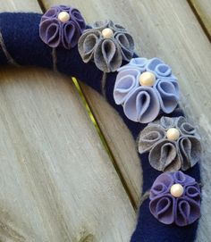 "Handmade felt flowers on 14"" foam wreath handwrapped in navy blue wool yarn - ""Blue Ridge"". $35.00, via Etsy."