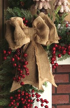 I love this bow with the red berries and greenery!!!!!!! Burlap is so country