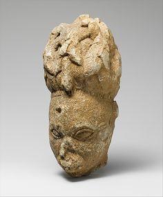 Figure: Head, Yoruba Peoples    Date:      12th–15th century  Geography:      Nigeria, Esie region, Offa  Culture:      Yoruba peoples  Medium:      Soapstone