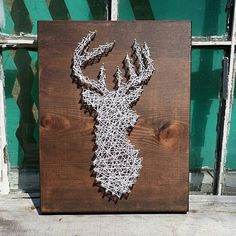 String Art Deer  A smaller version of one of our most popular designs! A 9 x 12 stained wood board with a deer silhouette made up of gold nail