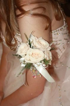 Arm band corsage for Prom, we had a lady attach the hanging iridescent heart beads