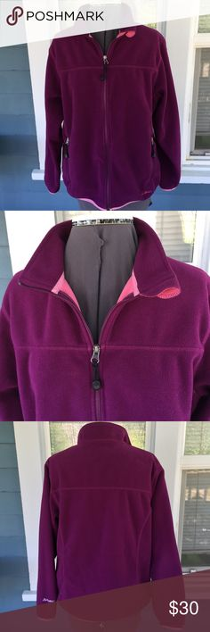 "L.L. BEAN Purple POLARTEC Jacket L.L. BEAN Purple POLARTEC Jacket.  Full zip front.  Long sleeves, 24"".  Zipper front pockets & 2 inside pockets.   Purple POLARTEC fleece with pink trim.  Shoulder width 17"".  Pit-to-pit 22"".  Length 24"" (shoulder to hem).   Great condition. L. L. Bean Jackets & Coats"