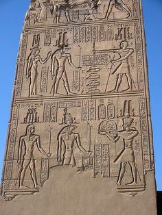 Sobek And Horus    This obelisk, standing near the entrance to the Kom Ombo Temple has illustrations of the two gods to which the temple is dedicated - Sobek, above; Horus, below.    Sobek was a cult god in this area of Egypt, and it seems likely that this temple was erected here as nearby sand-banks were a favourite basking ground for crocodiles.