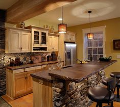 Home Design Kitchen. kitchen stone island design inspiration. Excellent Kitchen Island Stone Feature Wood Kitchen Cabinet And Grey Stone Wall Plus Tube Chandeliers Along With Marble Countertop Also Wooden Kitchen Carts Plus Glass Window Also Black Bar Stools Also