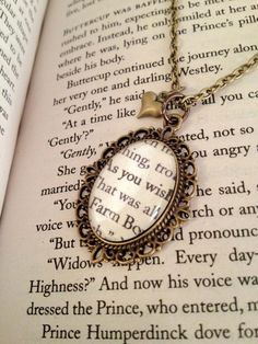 """Ohmigosh I LOVE it! She has famous quotes from Princess Bride enclosed in jewelry :) The Princess Bride """"As You Wish"""" Antiqued Bronze Book Page Necklace."""