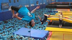 In this July 31, 2013, photo, Hunter Gottfredson, left, 15, of Elk Ridge, flips at the Get Air Hang Time indoor trampoline park in Orem, Utah. Indoor trampoline parks have cropped up around the country in recent years, but some doctors and officials say the parks are dangerous and can cause serious injuries.
