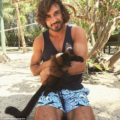 Holiday romance?Body Coach hunk Joe Wicks has sparked rumours he's dating Page 3 stunner Rosie Jones as they both enjoyed a romantic break in Necker Island at the same time