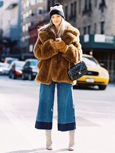 Fur coat, cropped wide-leg jeans, and boots