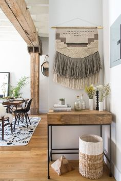 "To have a wall hanging as beautiful as this, check out our <a href=""https://www.homepolish.com/mag/weaving-your-own-wall-hanging"" target=""_blank"">tutorial</a>."