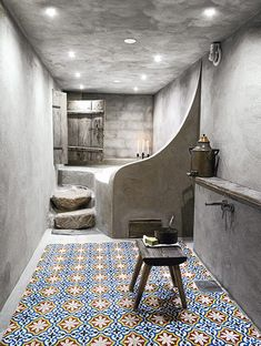 a swedish winter wonderland home - hammam style bathroom with tadelakt walls and beautiful Moroccan tiles on the floor