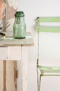 Pretty pale green bistro chair and bottle