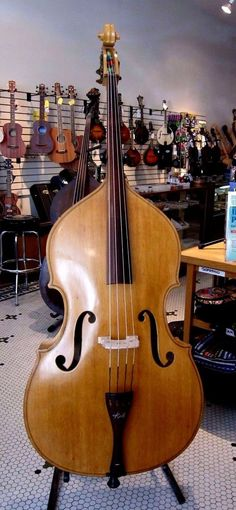 1951 KAY M1B VINTAGE UPRIGHT BASS #Kay When this bass found it's way to us she had not been played in 60 years, her heart was broken and she had decided to sleep. Some gentle nudging and some sweet care and brought her back to life again. But for this lady the only true healing of a broken heart is a new lover. Come by for a visit and court this lady, she is waiting.