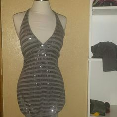 Halter Sequin Dress Very sexy sequined dress by Charlotte Russe. Dress ties around neck comfortably,  v - shaped neckline, padded cups, loose body, snug at bottom around thighs. Mint condition no stains, holes or tears, smoke free home. Charlotte Russe Dresses