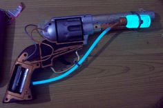 This is my steampunk revolver made for a Edinburgh steampunk event. One of my better mods. It can also be seen with my gear in the Steam-punk Scientist pictures. Steampunk Weapons, Steampunk Crafts, Steampunk Gadgets, Steampunk Gears, Steampunk Cosplay, Steampunk Fashion, Modified Nerf Guns, Steampunk Accessoires, Armas Ninja