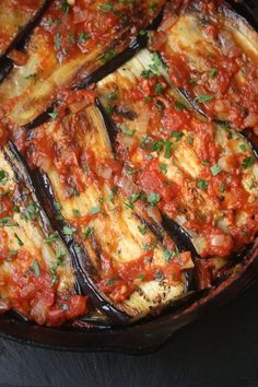 Imam Bayildi is a healthy vegan twist on the usual breaded, fried eggplant casserole. The slices are covered in Mediterranean tomato sauce and baked.
