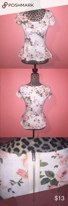Floral Pink Roses White Peplum Knit Top S Beautiful knit peplum top features pink delicate roses against a off white background. Peplum silhouette with an exposed zipper on the back. This would fit a junior size small. Gently used but in great condition! TOP IS NOT FROM FOREVER 21. Forever 21 Tops