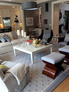 Grey geometrics and modern design help this great room connect with its surroundings at the 2015 Hampton Designer Showhouse. Designed by Patricia Fisher.
