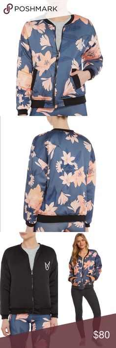 MINKPINK Midnight Romance Floral bomber jacket $99 NWT MINKPINK Midnight Romance Floral Bomber Reversible jacket  Size: medium  Black and blue with Coral Pink flowers   MINKPINK Midnight Romance Bomber Jacket features an eye-catching floral print and black banding on the collar, hem, cuffs and pockets.   70% Polyester, 25% Nylon, 5% Elastane.  Women's bomber jacket. Round neckline. Full-length front zipper. Black banding on neckline, pockets, cuffs and hem. Front hand pockets. Floral print…