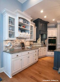 Open shelving. Not everybody loves the look of open shelving, but, when used appropriately, open shelves can make a kitchen look bigger and more interesting. They provide a way to highlight pretty kitchenware and streamlined organization, for example. They make items more accessible, with no need to open and close doors to retrieve and put away your things. Kitchen Design Ideas - The Jasper Hill 5020. #WeDesignDreams