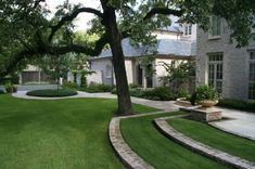 tiered lawn edged with brick, plus the walkway along the back of the house...or is this the front?