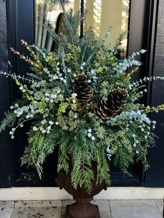 winter decor The Yellow Brick Home - Embrace Winter Wonders! Enjoy cozy interiors and the beauty of nature. Outdoor Christmas Planters, Christmas Porch, Farmhouse Christmas Decor, Winter Christmas, Christmas Wreaths, Outdoor Planters, Large Outdoor Christmas Decorations, French Country Christmas, Urn Planters
